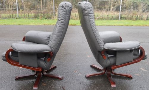 Pair Leather Swivel Armchairs and Footstools